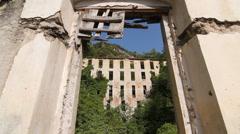 Looking through broken doorway at abandoned factory. Valley above Amalfi, Italy. - stock footage