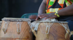 Man playing traditionals africans bongos Stock Footage