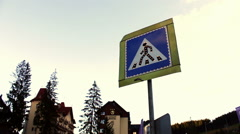 Sign of the pedestrian crossing on background sky and houses Stock Footage