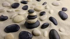 Stones pyramid on sand standing among the rocks Stock Footage