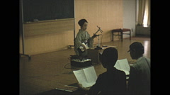 Vintage 16mm film, 1970, Japan, Shamisen music instruction in class Stock Footage