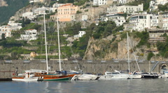 Boats moored in the harbour of Amalfi, Amalfi Coast, Italy. Stock Footage