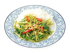 Quick-fried water spinach with chili, soy sauce and rice Stock Photos