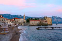 Evening view of the beach at the Old Town of Budva, Montenegro Stock Photos