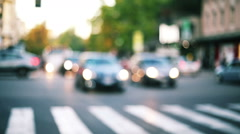 Shot of traffic context with biker riding into the traffic in blurred Stock Footage