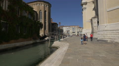 Mother with child and other tourists walking on Fondamenta Salute, Venice - stock footage
