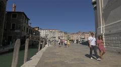 Tourists crossing a bridge over Rio de la Salute, Venice Stock Footage