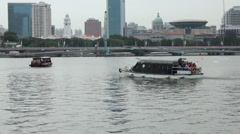 Pan from a water taxi to the city skyline. Marina Bay, Singapore. Stock Footage
