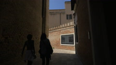 Stock Video Footage of Tourists walking on Calle Del Bastion and Calle Due Mori, Venice