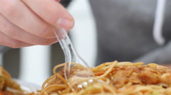 Eating fast food in china bistro - spaghetti pasta, roasted chicken in sauce - stock footage