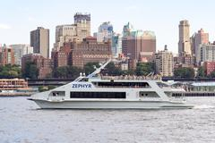 Tourism cruise boat in the New York Harbor with the Brooklyn sky Stock Photos