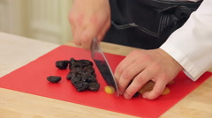 Chef is cutting dried apricots and prunes Stock Footage