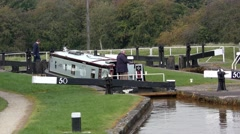 Canal barge narrowboat  lock people action countryside rural autumn Stock Footage