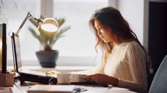 Happy businesswoman reading a white folder and working on her table Stock Footage
