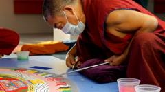 Tibetan monk making sand Mandala Kalachakra Stock Footage
