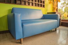 sofa blue and yellow light - stock photo