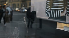 Reflections from a showcase of people walking Stock Footage