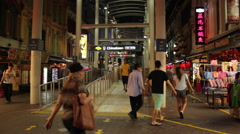 Nighttime, tourists walking out of the subway in Chinatown, Singapore.  Stock Footage