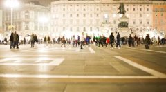 time lapse of people walking in the evening in a big city (Milan) with lights - stock footage