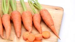 Fresh organic carrots on wood Stock Footage