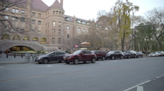 Mother and son cross street side entrance Museum of Natural History panning 4K Stock Footage