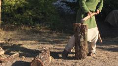 Lumberjack Boy is Cutting Wood with the Axe Stock Footage