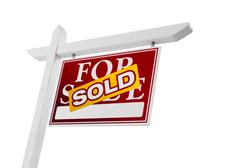 Red Sold For Sale Real Estate Sign Isolated on a White Background. Stock Photos