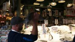 Salmon catching pike place market Stock Footage