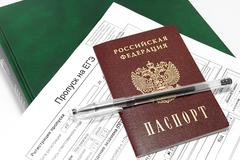 Skipping to the exam, a passport and a pen on the thick green book. Russia - stock photo