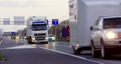 Border Germany trucks cars evening Stock Footage