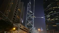 Stock Video Footage of Triangle lines illumination BOC skyscraper outline against dark sky