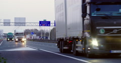 Border crossing Germany trucks cars evening Stock Footage