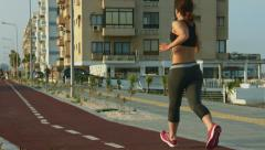 Young motivated woman jogging to have healthy fit body. Outdoor sport activity Stock Footage