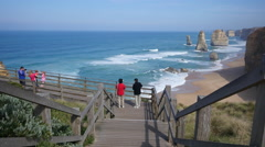 Australia Great Ocean Road 12 Apostles tourists on boardwalk Stock Footage