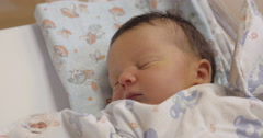 A new-born being asleep and then waking up Stock Footage