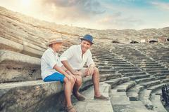 Father with son spent time together on the antique ruins Stock Photos