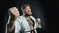 Aggressive karate fighter Stock Photos