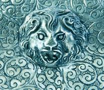 Silverware background with lion - stock photo