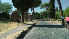 Appian Way, bicylists pass, Rome Stock Footage