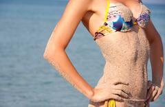 Stock Photo of Heat, sea, sand and bikini woman