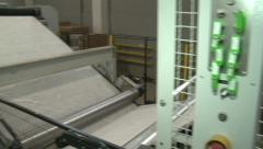 Manufacture of medical wadding. The conveyor. Linen. Wadding - stock footage