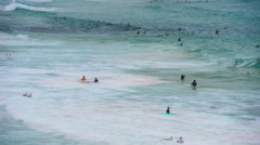 Swimmers enjoying the surf at bondi beach on a hot summer day Stock Footage