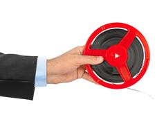 Stock Photo of Cinema film reel in hand