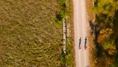 Stock Video Footage of 4K Aerial: Bird View over Bikers Shadow in Countryside