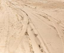 Road in the sand on the lake Stock Photos