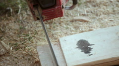 Carpenter cutting and carving timber wood using chainsaw Stock Footage
