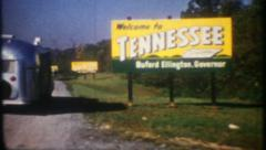 2775 - Tennessee stateline billboard, boundary marker - vintage film home movie Stock Footage