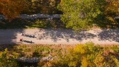 4K Aerial: Top Tracking Bikers on Forest Dirt road Stock Footage