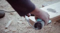 Carpenter polishing timber wood using grinder Stock Footage