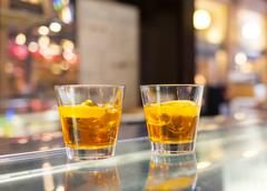 glasses of spritz aperitif cocktail with orange slices - stock photo